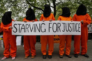 (photo via google images from: http://www.csmonitor.com/var/ezflow_site/storage/images/media/content/2013/07012/0701-hunger-striking-guantanamo-detainees/16248453-1-eng-US/0701-Hunger-striking-Guantanamo-detainees_full_600.jpg )