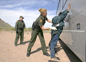 CBP Border Patrol agent does a pat down of a female Mexican being returned to Mexico.